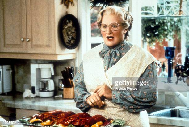 Robin Williams in the kitchen in a scene from the film 'Mrs Doubtfire' 1993