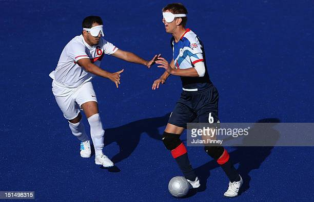 Robin Williams of Great Britain goes past Ramazan Kunduz of Turkey in the 78 classification match between Great Britain and Turkey during the 5 aside...
