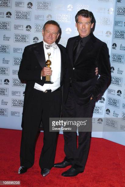 Robin Williams winner of the Cecil B DeMille award and Pierce Brosnan