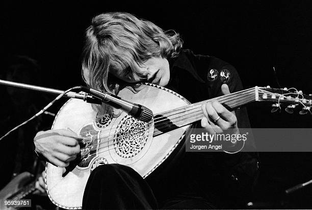 Robin Williamson of The Incredible String Band performs on stage playing a sitar c1974 in Copenhagen Denmark