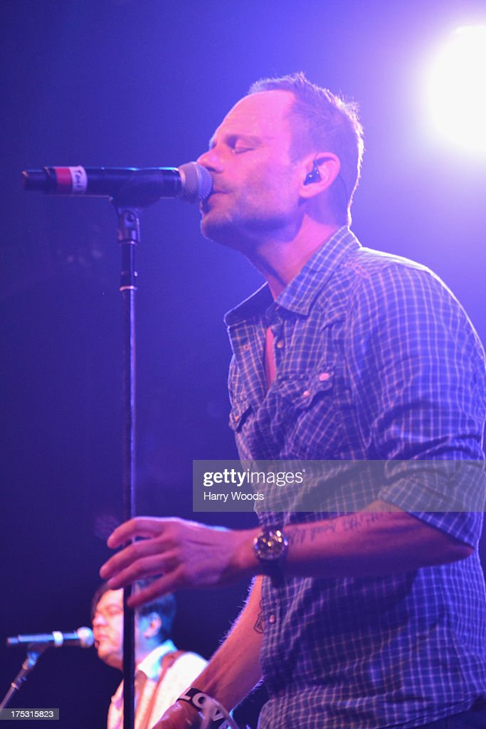 <a gi-track='captionPersonalityLinkClicked' href=/galleries/search?phrase=Robin+Wilson+-+Musician&family=editorial&specificpeople=14247852 ng-click='$event.stopPropagation()'>Robin Wilson</a> performs with the Gin Blossoms during Bud Light Music First 50/50/1 on August 1, 2013 in Hampton, New Hampshire.