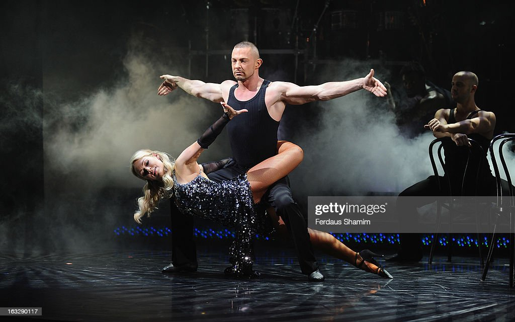 Robin Windsor and Kristina Rhihanoff perform during a photocall for 'Burn The Floor' at Shaftesbury Theatre on March 7, 2013 in London, England.