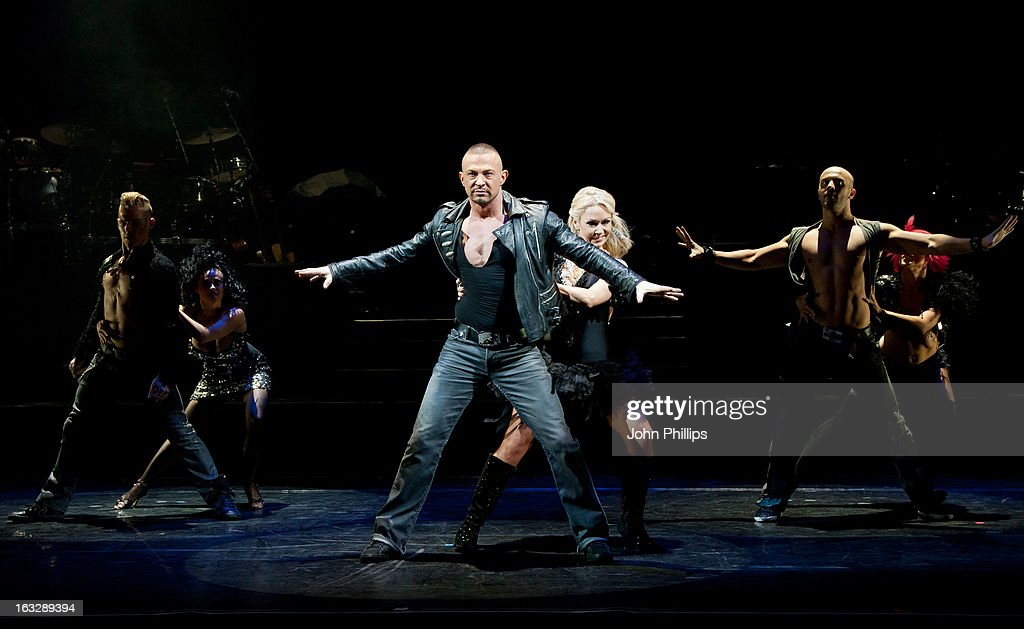 Robin Windsor and <a gi-track='captionPersonalityLinkClicked' href=/galleries/search?phrase=Kristina+Rihanoff&family=editorial&specificpeople=5584816 ng-click='$event.stopPropagation()'>Kristina Rihanoff</a> perform during a photocall for 'Burn The Floor' at Shaftesbury Theatre on March 7, 2013 in London, England.