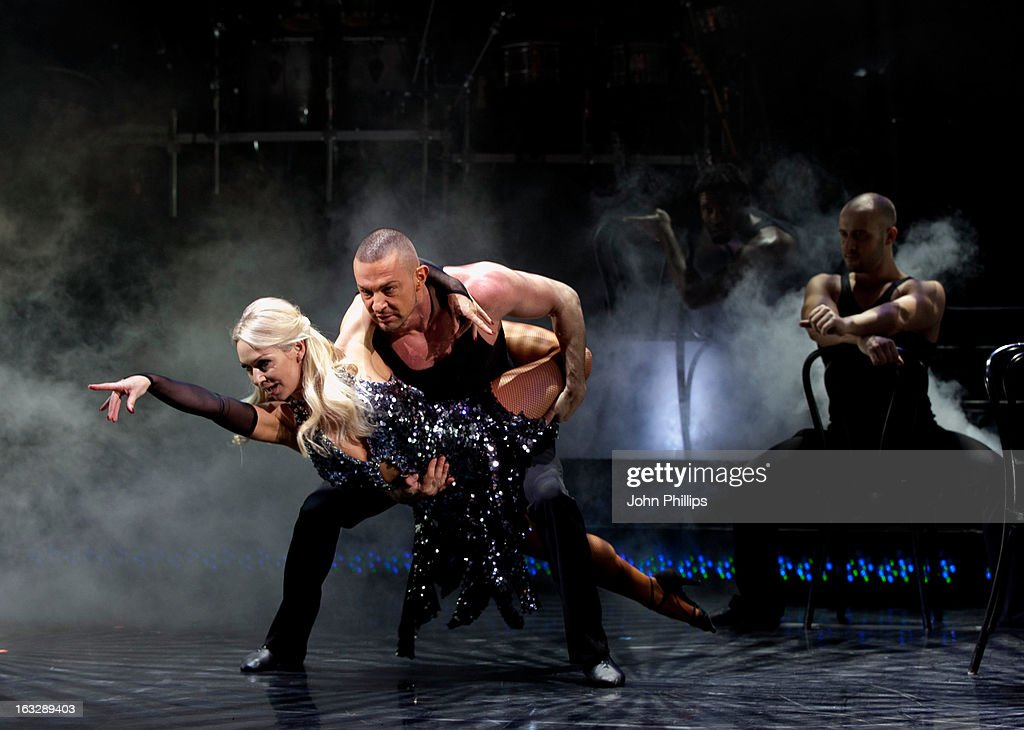 Robin Windsor and Kristina Rihanoff perform during a photocall for 'Burn The Floor' at Shaftesbury Theatre on March 7, 2013 in London, England.