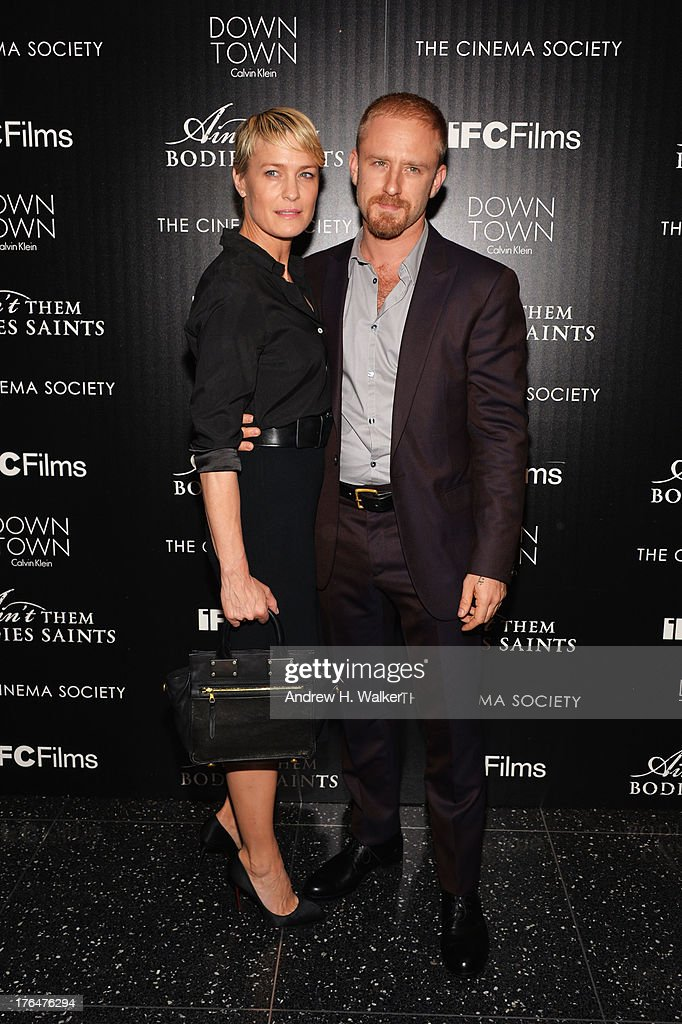 <a gi-track='captionPersonalityLinkClicked' href=/galleries/search?phrase=Robin+Wright&family=editorial&specificpeople=207147 ng-click='$event.stopPropagation()'>Robin Wright</a> (L) and Ben Foster (R) attend the Downtown Calvin Klein with The Cinema Society screening of IFC Films' 'Ain't Them Bodies Saints' at the Museum of Modern Art on August 13, 2013 in New York City.