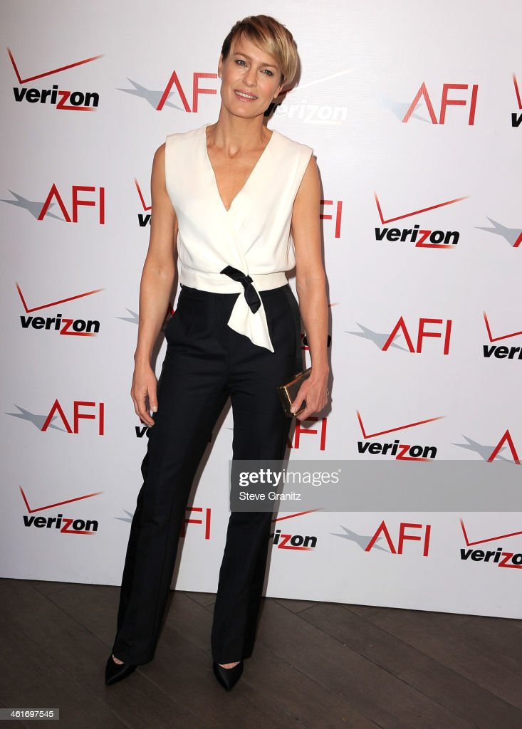 <a gi-track='captionPersonalityLinkClicked' href=/galleries/search?phrase=Robin+Wright&family=editorial&specificpeople=207147 ng-click='$event.stopPropagation()'>Robin Wright</a> arrives at the American Film Institute Awards Luncheon at Four Seasons Hotel Los Angeles at Beverly Hills on January 10, 2014 in Beverly Hills, California.