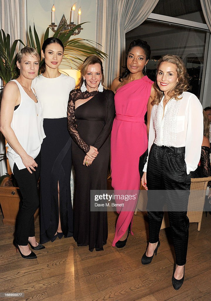 Robin Wright, Olga Kurylenko, Caroline Scheufele, Naomie Harris and Noomi Rapace attend the annual Finch's Quarterly Review Filmmakers Dinner hosted by Charles Finch, Caroline Scheufele and Nick Foulkes at Hotel Du Cap Eden Roc on May 17, 2013 in Antibes, France.