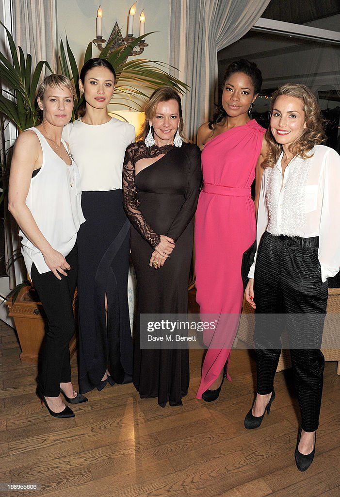 <a gi-track='captionPersonalityLinkClicked' href=/galleries/search?phrase=Robin+Wright&family=editorial&specificpeople=207147 ng-click='$event.stopPropagation()'>Robin Wright</a>, <a gi-track='captionPersonalityLinkClicked' href=/galleries/search?phrase=Olga+Kurylenko&family=editorial&specificpeople=630281 ng-click='$event.stopPropagation()'>Olga Kurylenko</a>, Caroline Scheufele, <a gi-track='captionPersonalityLinkClicked' href=/galleries/search?phrase=Naomie+Harris&family=editorial&specificpeople=238918 ng-click='$event.stopPropagation()'>Naomie Harris</a> and <a gi-track='captionPersonalityLinkClicked' href=/galleries/search?phrase=Noomi+Rapace&family=editorial&specificpeople=4522889 ng-click='$event.stopPropagation()'>Noomi Rapace</a> attend the annual Finch's Quarterly Review Filmmakers Dinner hosted by Charles Finch, Caroline Scheufele and Nick Foulkes at Hotel Du Cap Eden Roc on May 17, 2013 in Antibes, France.