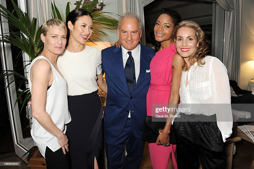 Robin Wright, Olga Kurylenko, Charles Finch, Naomie Harris and Noomi Rapace attend the annual Finch's Quarterly Review Filmmakers Dinner hosted by Charles Finch, Caroline Scheufele and Nick Foulkes at Hotel Du Cap Eden Roc on May 17, 2013 in Antibes, France.