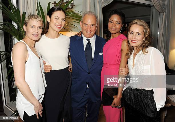 Robin Wright Olga Kurylenko Charles Finch Naomie Harris and Noomi Rapace attend the annual Finch's Quarterly Review Filmmakers Dinner hosted by...