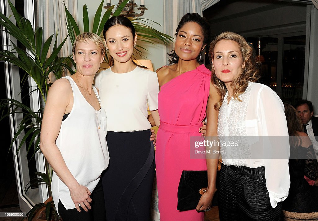 Robin Wright, Olga Kurylenko, Naomie Harris and Noomi Rapace attend the annual Finch's Quarterly Review Filmmakers Dinner hosted by Charles Finch, Caroline Scheufele and Nick Foulkes at Hotel Du Cap Eden Roc on May 17, 2013 in Antibes, France.