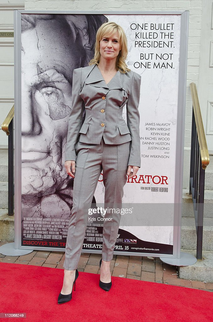 Robin Wright poses for photographers on the red carpet during the premiere of 'The Conspirator' presented by The American Film Company, Ford's Theatre and Roadside Attractions at Ford's Theatre on April 10, 2011 in Washington, DC.