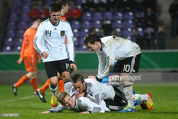 Robin Yalcin Marvin Duksch Samed Yesil and Thomas Pledl of Germany celebrate their teams first goal during the U18 international friendly match...