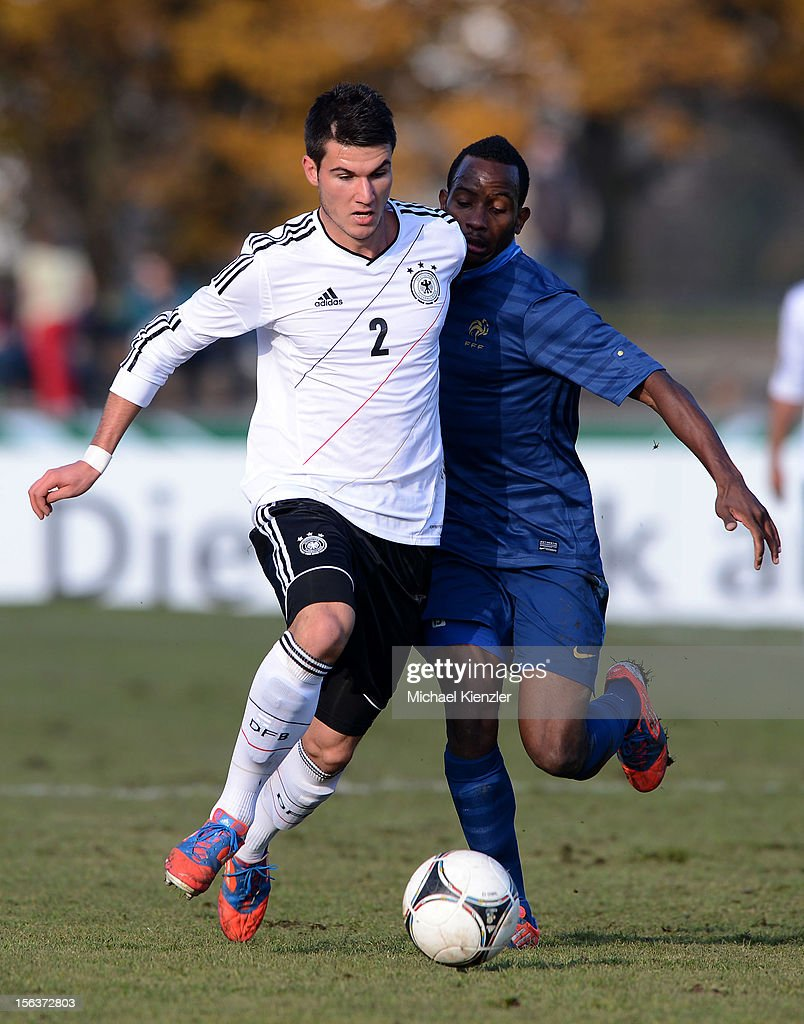Robin Yalcin (l) of Germany challenges Lenny Nangis during the International Friendly match between U19 Germany and U19 France at Rheinstadium on November 14, 2012 in Kehl, Germany.