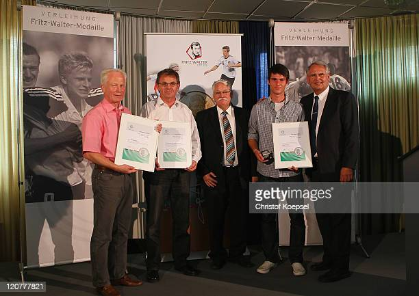 Robin Yalcin presents the silver medal of the category best youth player U17 with HansDieter Drewitz vicepresident juniors of the German Football...