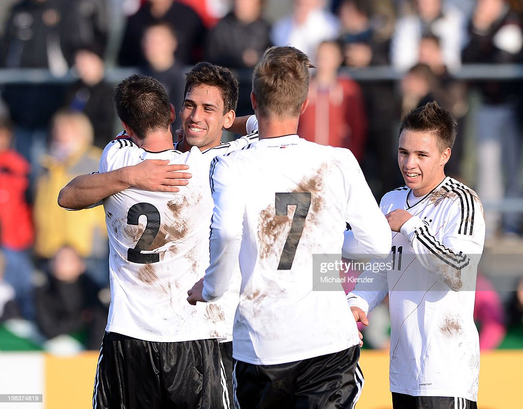 Robin Yalcin, Rani Khedira, Yannick Gerhardt and Thomas Pledl (l-r) celebrating Khediras scoring Ger,amy's 2nd goal, during the International Friendly match between U19 Germany and U19 France at Rheinstadium on November 14, 2012 in Kehl, Germany.