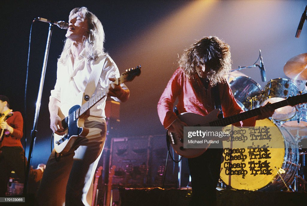 Robin Zander and Tom Petersson performing on stage with American rock group Cheap Trick circa 1979 On the far left and far right are guitarist Rick...