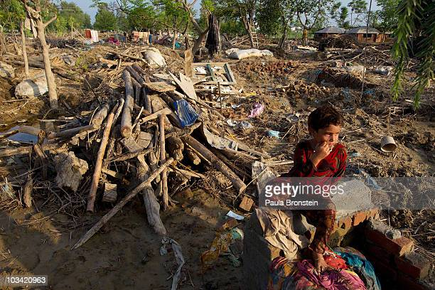 Robina sits amongst the rubble of her destroyed home August 17 2010 in Charsadda Pakistan The country's agricultural heartland has been devastated...