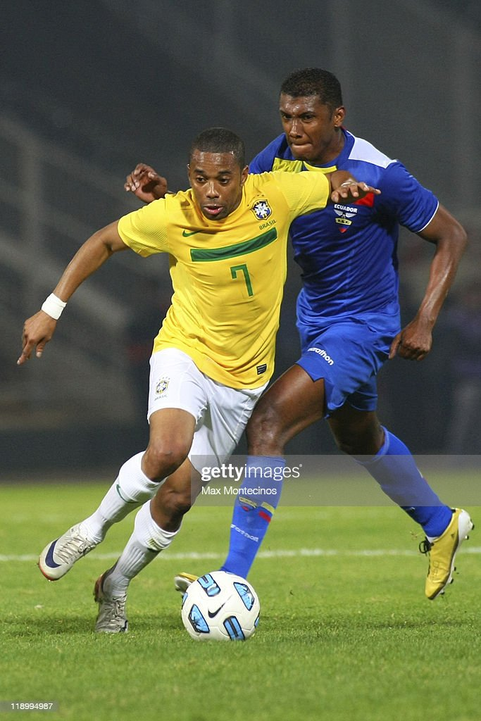 Robinho from Brazil fights for the ball with Oswaldo Minda from Ecuador during a match between Brazil and Ecuador as part of the Group B of the Copa...