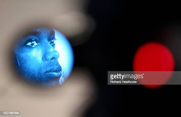 Robinho is seen through the viewfinder of a TV camera as he speaks to the media during the Brazil team press conference at The Fairways Hotel on June...