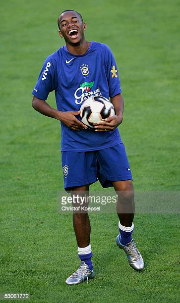 Robinho laughs during the Brazilian National Team training session for the FIFA Confederations Cup 2005 on June 13 2005 in Leverkusen Germany