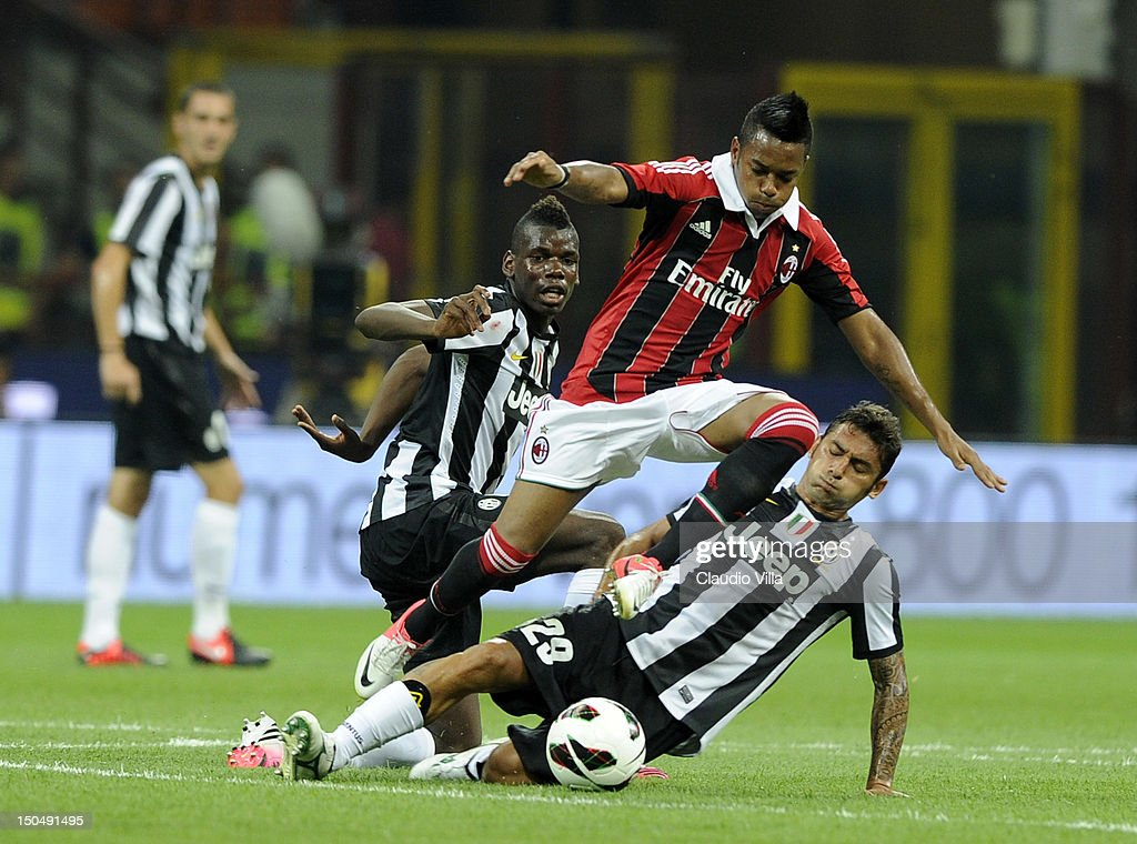 Robinho of AC Milan and Luca Marrone of Juventus FC compete for the ball during the Berlusconi Trophy match between AC Milan and Juventus FC at...