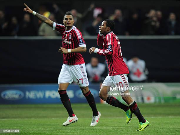Robinho of AC Milan celebrates his second goal with KevinPrince Boateng of AC Milan during the UEFA Champions League round of 16 first leg match...