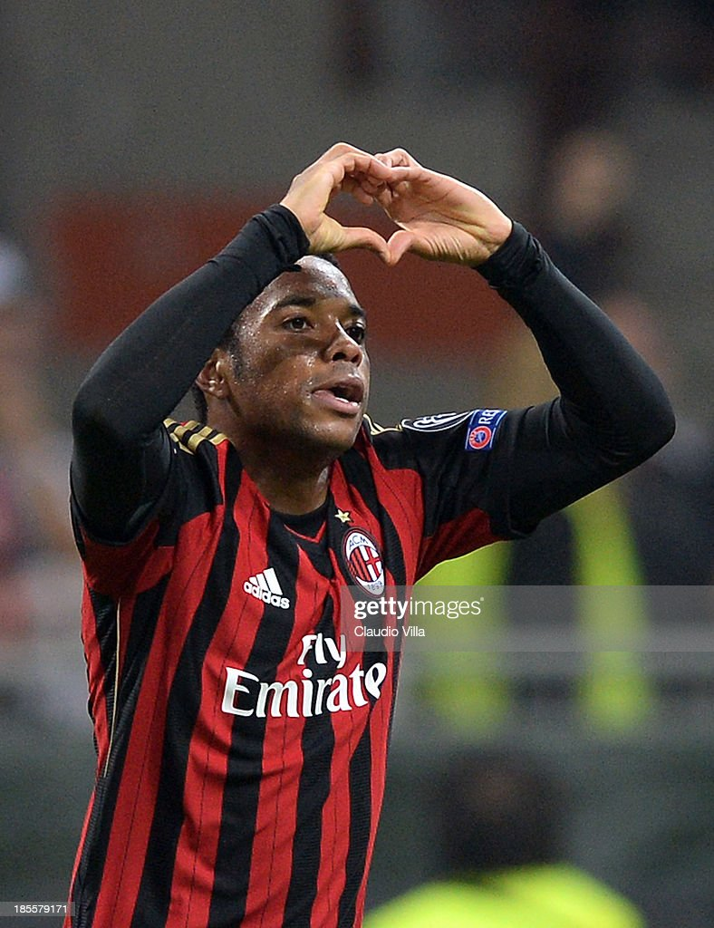 <a gi-track='captionPersonalityLinkClicked' href=/galleries/search?phrase=Robinho&family=editorial&specificpeople=210767 ng-click='$event.stopPropagation()'>Robinho</a> of AC Milan celebrates scoring the first goal during the UEFA Champions League Group H match between AC Milan and Barcelona at Stadio Giuseppe Meazza on October 22, 2013 in Milan, Italy.