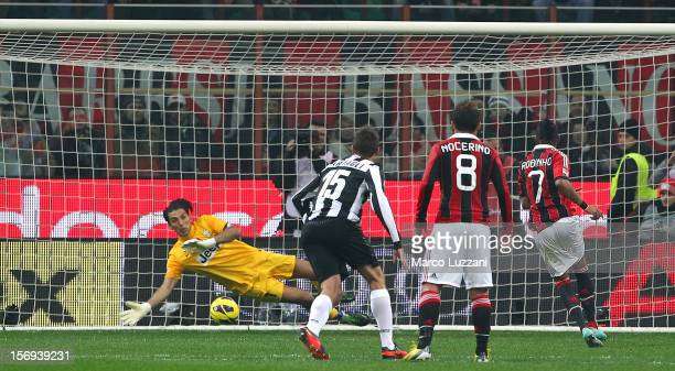 Robinho of AC Milan scores the opening goal from the penalty spot during the Serie A match between AC Milan and Juventus FC at San Siro Stadium on...