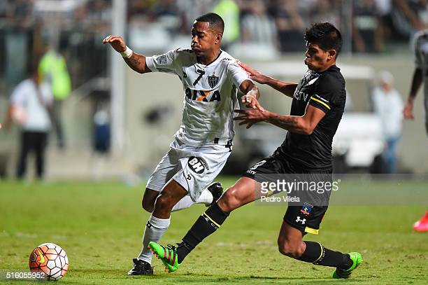 Robinho of Atletico MG and Esteban Pavez of Colo Colo battle for the ball during a match between Atletico MG and Colo Colo as part of Copa...