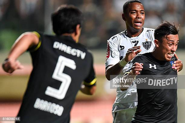Robinho of Atletico MG and Martin Rodriguez of Colo Colo battle for the ball during a match between Atletico MG and Colo Colo as part of Copa...
