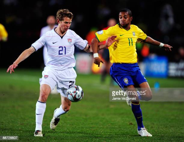 Robinho of Brazil battles with Jonathan Spector of the USA during the FIFA Confederations Cup Final match between USA and Brazil at Ellis Park...