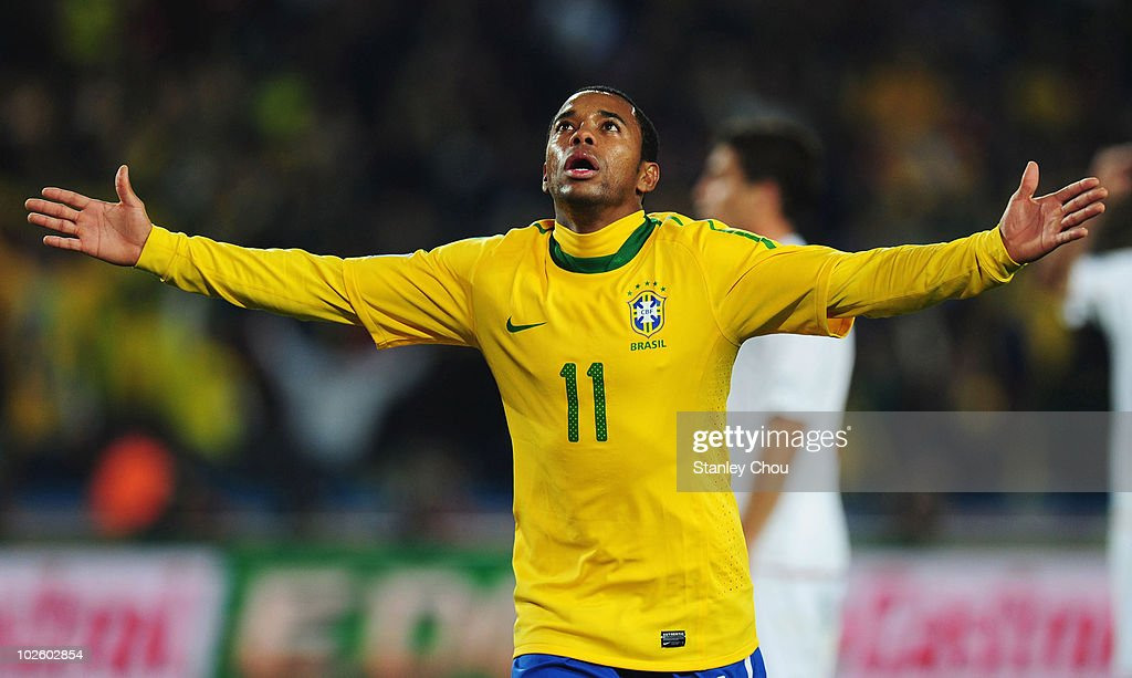 <a gi-track='captionPersonalityLinkClicked' href=/galleries/search?phrase=Robinho&family=editorial&specificpeople=210767 ng-click='$event.stopPropagation()'>Robinho</a> of Brazil celebrate scoring during the 2010 FIFA World Cup South Africa Round of Sixteen match between Brazil and Chile at Ellis Park Stadium on June 28, 2010 in Johannesburg, South Africa.