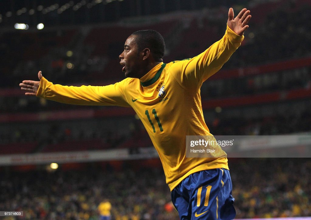 Robinho of Brazil celebrates after Keith Andrews of Ireland scored an own goal from his cross for Brazil's first goal during the International...