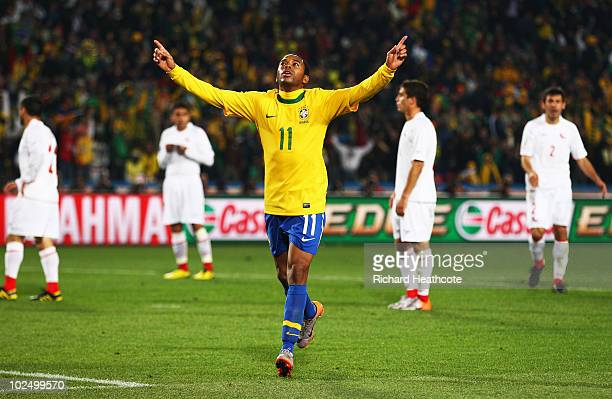 Robinho of Brazil celebrates scoring his side's third goal during the 2010 FIFA World Cup South Africa Round of Sixteen match between Brazil and...