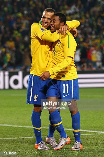 Robinho of Brazil celebrates scoring his side's third goal with team mate Luis Fabiano during the 2010 FIFA World Cup South Africa Round of Sixteen...