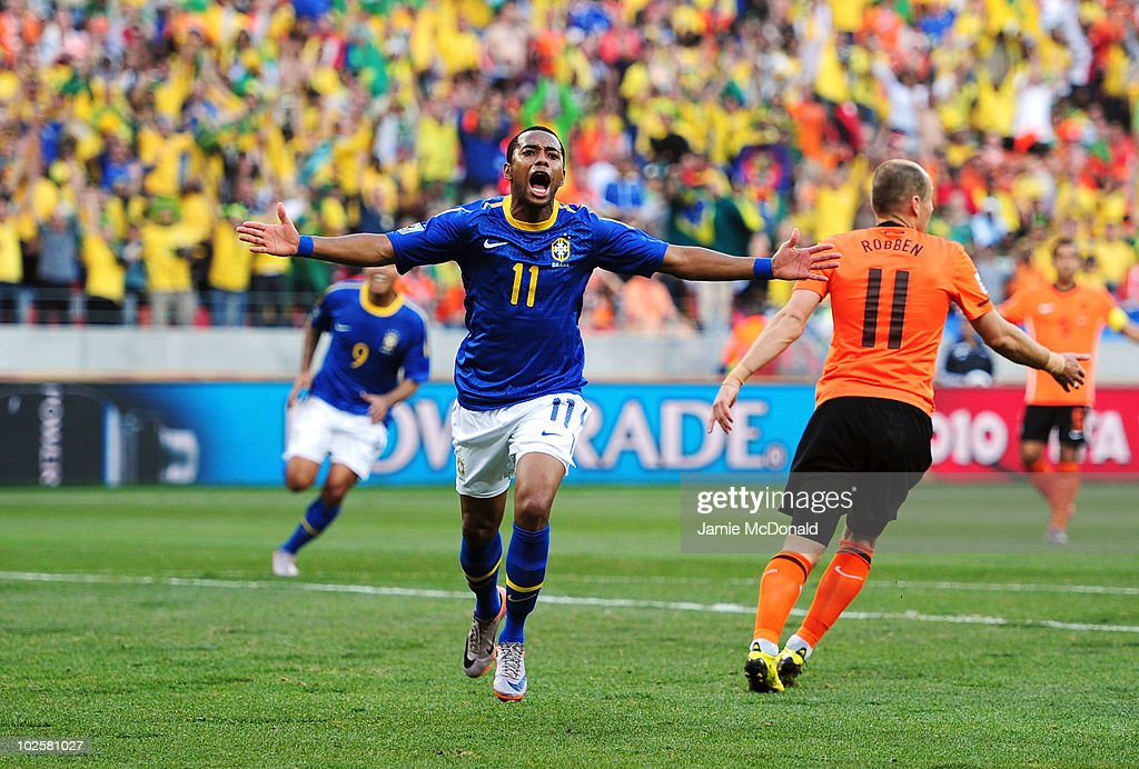 <a gi-track='captionPersonalityLinkClicked' href=/galleries/search?phrase=Robinho&family=editorial&specificpeople=210767 ng-click='$event.stopPropagation()'>Robinho</a> of Brazil celebrates scoring the opening goal during the 2010 FIFA World Cup South Africa Quarter Final match between Netherlands and Brazil at Nelson Mandela Bay Stadium on July 2, 2010 in Nelson Mandela Bay/Port Elizabeth, South Africa.