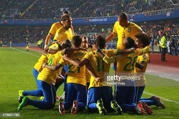 Robinho of Brazil celebrates with teammates after scoring the opening goal during the 2015 Copa America Chile quarter final match between Brazil and...