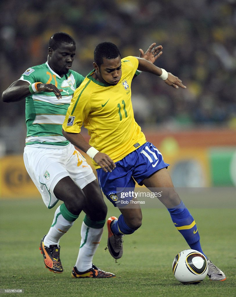 Robinho of Brazil challenged by Emmanuel Eboue of the Ivory Coast during the 2010 FIFA World Cup South Africa Group G match between Brazil and Ivory...