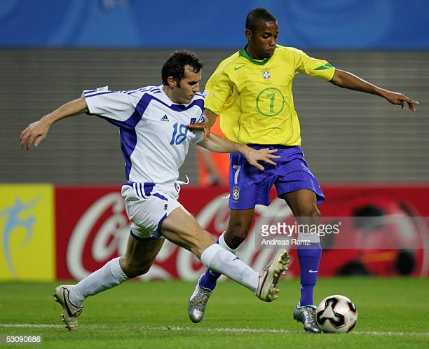 Robinho of Brazil challenges with Ioannis Goumas of Greece during the FIFA Confederations Cup 2005 match between Brazil and Greece on June 16 2005 in...