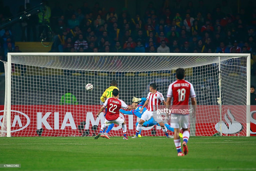 Robinho of Brazil shoots to score the opening goal during the 2015 Copa America Chile quarter final match between Brazil and Paraguay at Ester Roa...