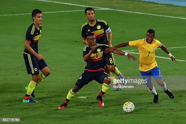 Robinho of Brazil struggles for the ball with Farid Diaz of Colombia during a match between Brazil and Colombia as part of Friendly Match In Memory...