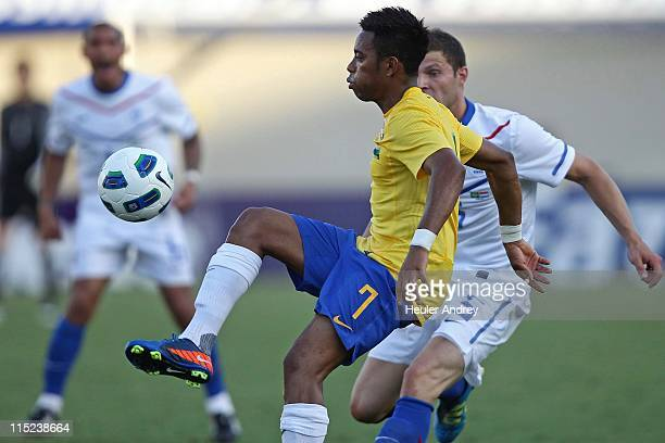 Robinho of Brazil struggles for the ball with Pieters of Holland during a friendly match at Serra Dourada on June 4 2011 in Goiania Brazil