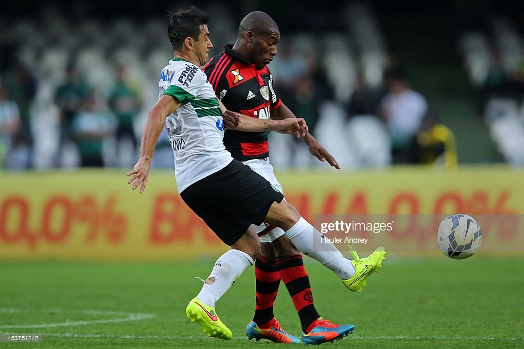 <a gi-track='captionPersonalityLinkClicked' href=/galleries/search?phrase=Robinho&family=editorial&specificpeople=210767 ng-click='$event.stopPropagation()'>Robinho</a> of Coritiba competes for the ball with Amaral of Flamengo during the match between Coritiba and Flamengo for the Brazilian Series A 2014 at Couto Pereira stadium on August 17, 2014 in Curitiba, Brazil.