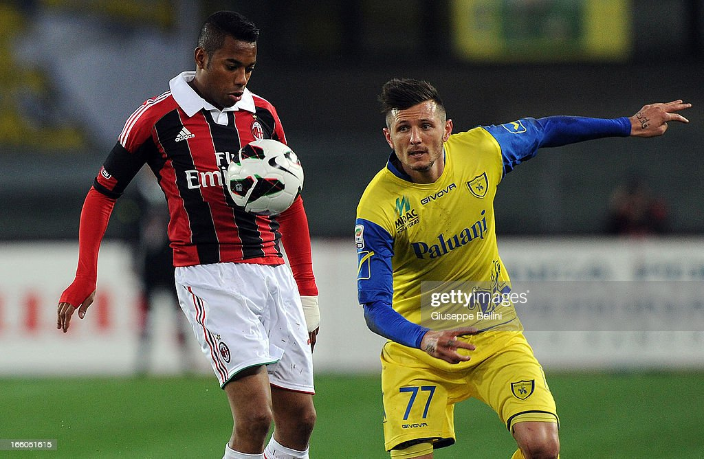 <a gi-track='captionPersonalityLinkClicked' href=/galleries/search?phrase=Robinho&family=editorial&specificpeople=210767 ng-click='$event.stopPropagation()'>Robinho</a> of Milan and Cyril Thereau of Chievo in acton during the Serie A match between AC Chievo Verona and AC Milan at Stadio Marc'Antonio Bentegodi on March 30, 2013 in Verona, Italy.