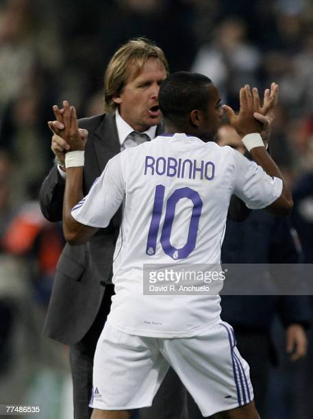 Robinho of Real madrid celebrates his first goal with his coach Bernd Schuster during the Champions League match between Real Madrid and Olympiakos...