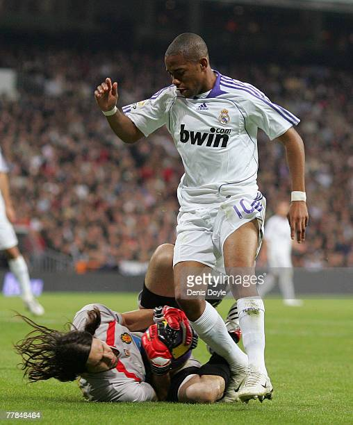 Robinho of Real Madrid loses the ball to Mallorca goalkeeper German Lux during the La Liga match between Real Madrid and Mallorca at the Santiago...