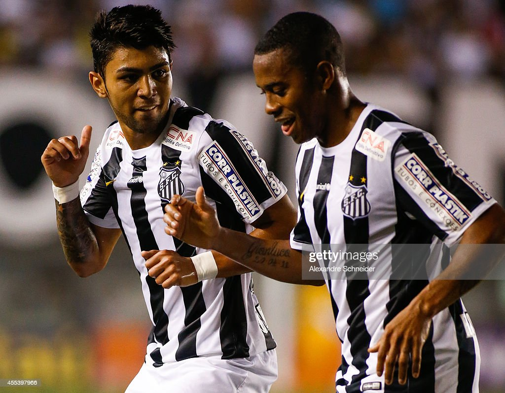 Robinho of Santos and Gabriel celebrate their second goal during the match between Santos and Coritiba for the Brazilian Series A 2014 at Vila...