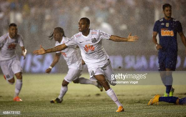 Robinho of Santos celebrates scoring the first goal during the match between Santos and Cruzeiro for Copa do Brasil 2014 at Vila Belmiro Stadium on...