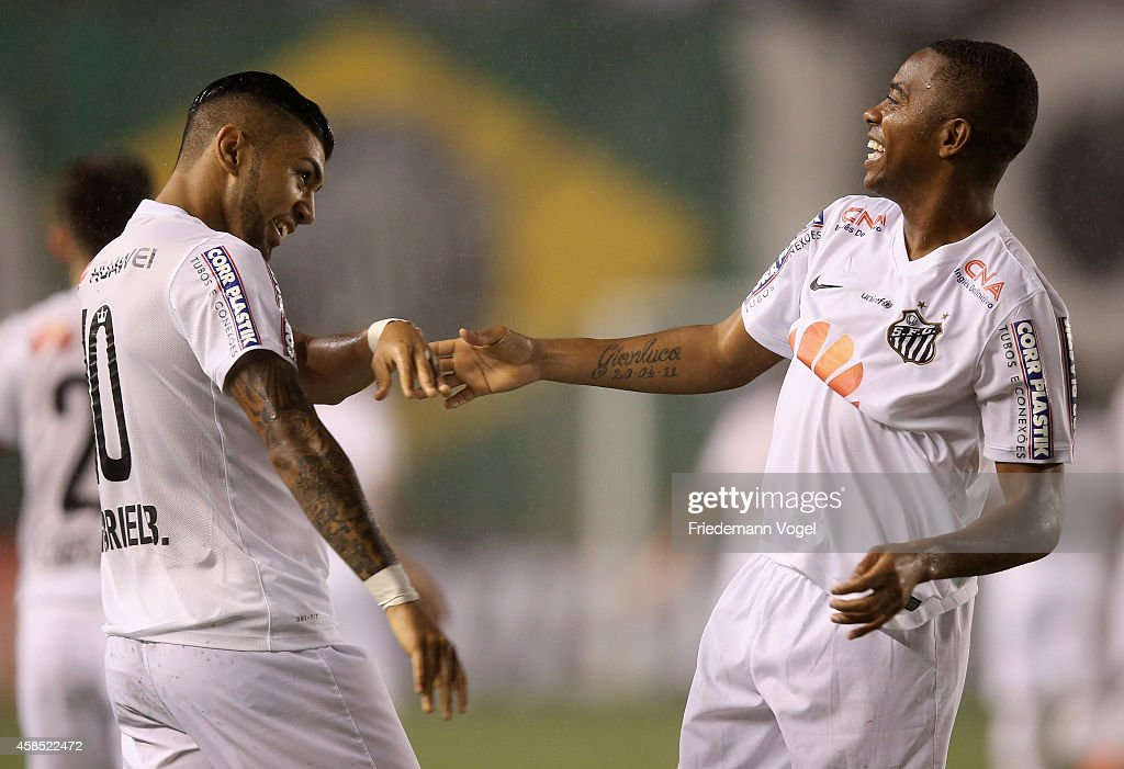 Robinho of Santos celebrates scoring the first goal with Gabriel during the match between Santos and Cruzeiro for Copa do Brasil 2014 at Vila Belmiro...